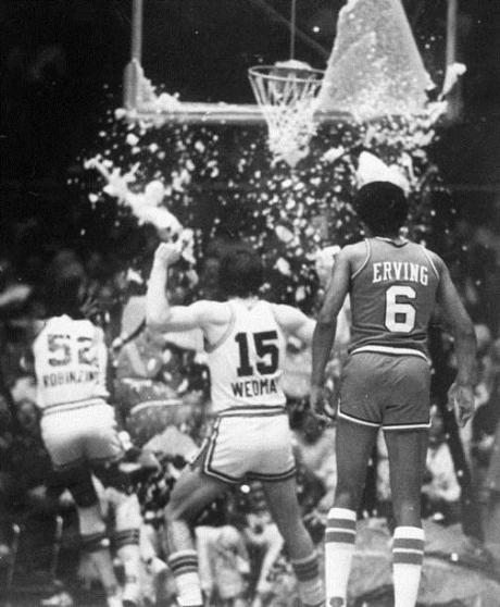 Broken backboard rains glass on Darryl Dawkins after a Chocolate Thunder Dunk , an Epic Leap in front of The Doctor in the House.